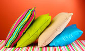 Pillows on red background — Stock Photo