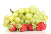 Ripe sweet grapes and strawberries isolated on white — Stock Photo