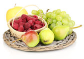 Ripe sweet fruits and berries on wicker mat isolated on white — Stock Photo