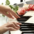 Hands of womplaying synthesizer — Stock Photo #12100763