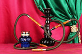 Hookah on a wooden table on a background of curtain close-up — Stock Photo