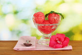 Watermelon ice cream in a glass goblet on green background close-up — Stock Photo