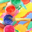 Jars with colorful gouache on a bright picture close-up — Stock Photo