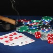Four of a kind on a blue poker table with dollars, playing cards and poker chips — Stock Photo