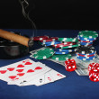 Four of a kind on a blue poker table with dollars, playing cards and poker chips — Stock Photo #12131670