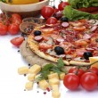 Stock Photo: Delicious pizza, vegetables and salami isolated on white