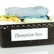 Donation box with clothing isolated on white — Stock Photo #12138193