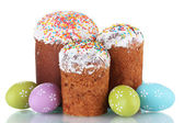 Beautiful Easter cakes and colorful eggs isolated on white — Stock fotografie