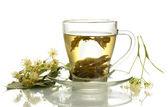 Cup of linden tea and flowers isolated on white — Stock Photo