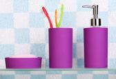 Bath accessories on shelf in bathroom — Stock Photo