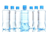 Plastic bottles of water isolated on white — Stock Photo