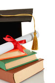 Sombrero grad y diploma con libros aislados en blanco — Foto de Stock
