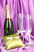 Wedding accessories on purple cloth background — Stock Photo