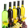 Bottles and glasses of wine and ripe grapes isolated on white — Stock Photo #12142454