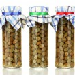 Glass jars with tinned capers isolated on white — Stock Photo
