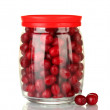 Fresh cornel berries in glass jar isolated on white — Stock Photo
