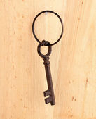 Antique key on wooden background — Stock Photo