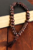 The Wooden rosary beads and holy bible close-up — Stock Photo