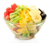 Fresh fruits salad in bowl isolated on white — Stock Photo