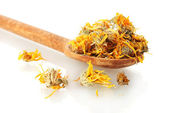 Dried calendula flowers in wooden spoon, isolated on white — Stock Photo