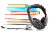 Headphones on books isolated on white — Stock Photo