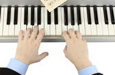 Hands of man playing piano — Stock Photo