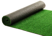 Artificial rolled green grass, isolated on white — Stock Photo