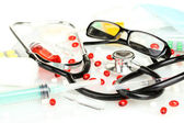 Medicines and a stethoscope on a white background close-up — Stock Photo