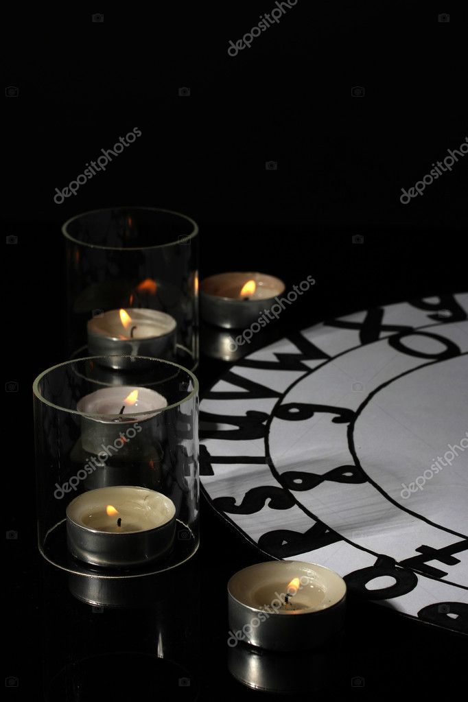 Spiritualistic seance by candlelight close-up — Stock Photo #12161455