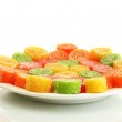 Colorful jelly candies on plate isolated on white — Stock Photo #12184185