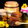 Still life of honey on black background — Stock Photo