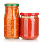 Jars with lecho and tomato paste isolated on white — Stock Photo