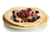 Delicious pancakes with berries and chocolate on plate isolated on white — Stock Photo