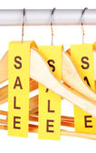 Wooden clothes hangers as sale symbol isolated on white — Stock Photo