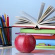 Composition of books, stationery and an apple on bright colorful background — Stock Photo #12191025