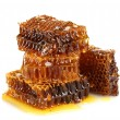 Sweet honeycombs with honey, isolated on white — Stok fotoğraf