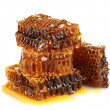 Foto Stock: Sweet honeycombs with honey, isolated on white