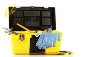 Open yellow tool box with tools isolated on white background — Stock Photo