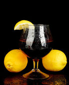 Glass of brandy isolated on black background close-up — Stock Photo