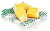 Fresh corn pieces on napkin isolated on white — Stock Photo