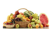 Assortment of exotic fruits and berries in baskets isolated on white — Stock Photo