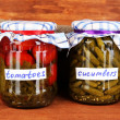Jars with canned vegetables on green background close-up - Zdjęcie stockowe