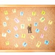 Stock Photo: Keys with many question marks on cork board