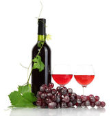 Bottle, glasses of wine and ripe grapes isolated on white — Stock Photo
