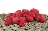 Fresh raspberries on wicker mat close-up — Stock Photo