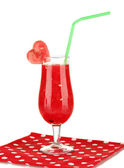 A glass of fresh watermelon juice on napkin on white background close-up — Stock Photo