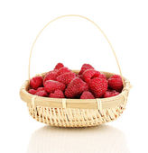 Ripe raspberries in basket isolated on white — Stock Photo