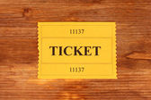 Colorful ticket on wooden background close-up — Stock Photo