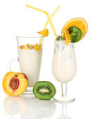 Delicious milk shakes with fruit isolated on white — Stock Photo