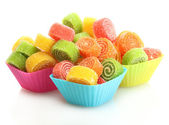 Sweet jelly candies in cup cake cases isolated on white — Stock Photo
